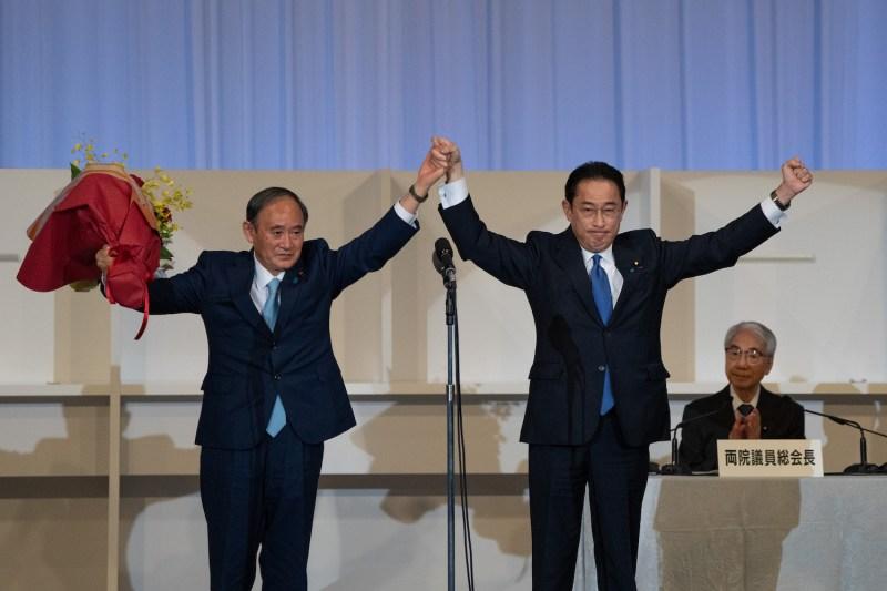Former Japanese Foreign Minister Fumio Kishida celebrates leadership win.