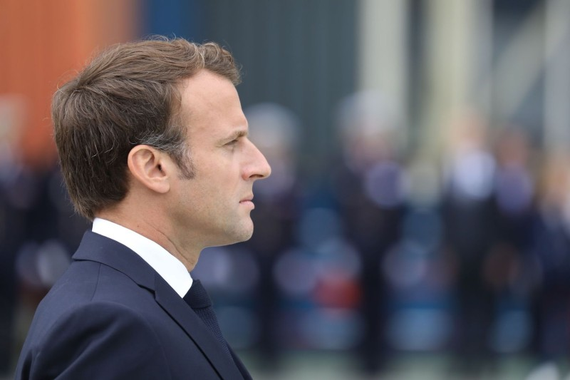 """French President Emmanuel Macron takes part in a military ceremony before the official launch of the new French nuclear submarine """"Suffren"""" built by Naval Group at the French naval base on July 12, 2019, in Cherbourg, France."""