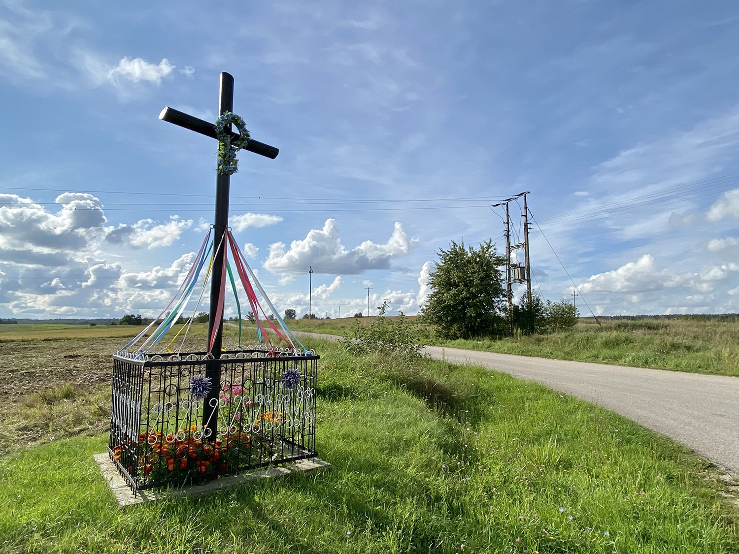 A traditional cross sits at the crossroads in the rural area of Podlasie, northeastern Poland, on Aug. 27.
