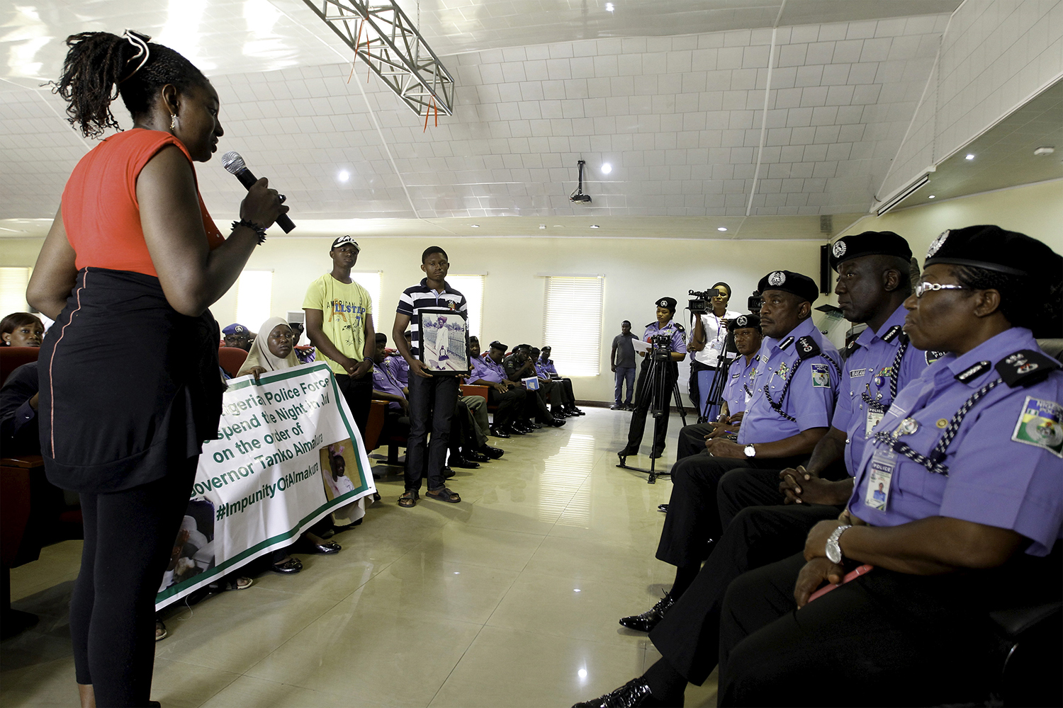 A woman speaks against police violence in Abuja, Nigeria.