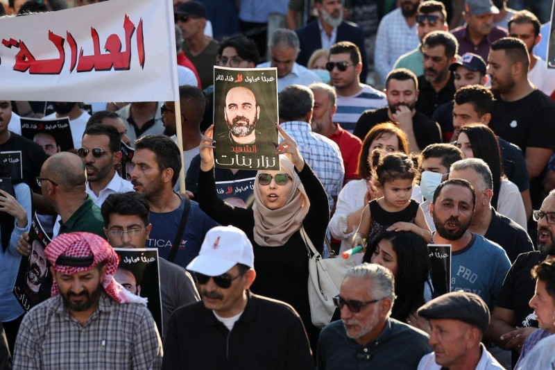 Palestinians rally to denounce the Palestinian Authority following the violent arrest and death in custody of the activist Nizar Banat in Ramallah, West Bank, on Aug. 2.