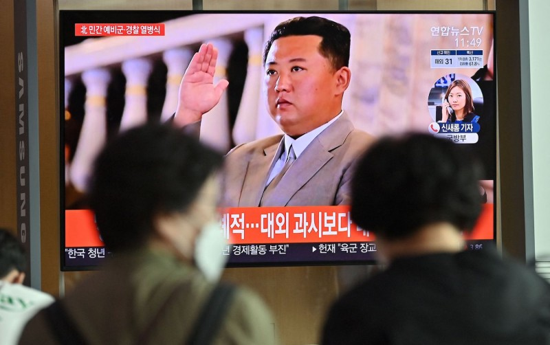 A North Korean military parade is seen on a news program in South Korea.