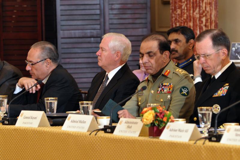 U.S. and Pakistani leaders listen during State Department meeting.