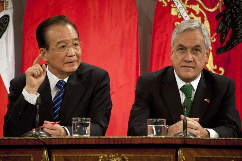 Chilean President Sebastián Piñera (right) and then-Chinese Premier Wen Jiabao speak after the signing of agreements at La Moneda presidential palace in Santiago, Chile, on June 26, 2012.