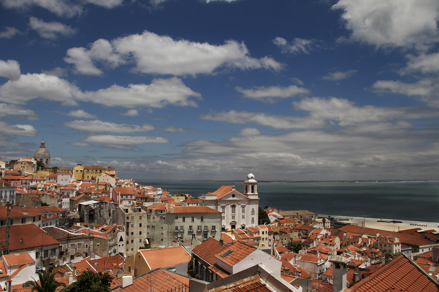 A view of Lisbon's tiled rooftops in the Alfama neighborhood.