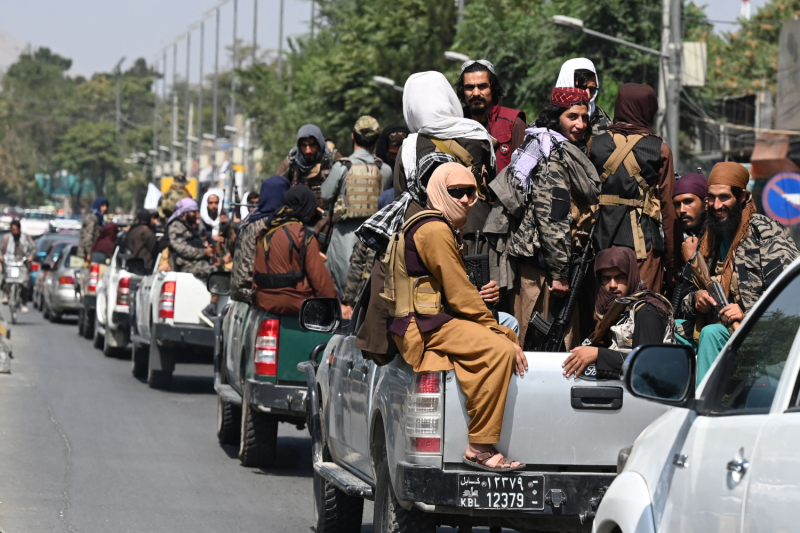 A convoy of Taliban fighters patrol along a street in Kabul on Sept. 2.