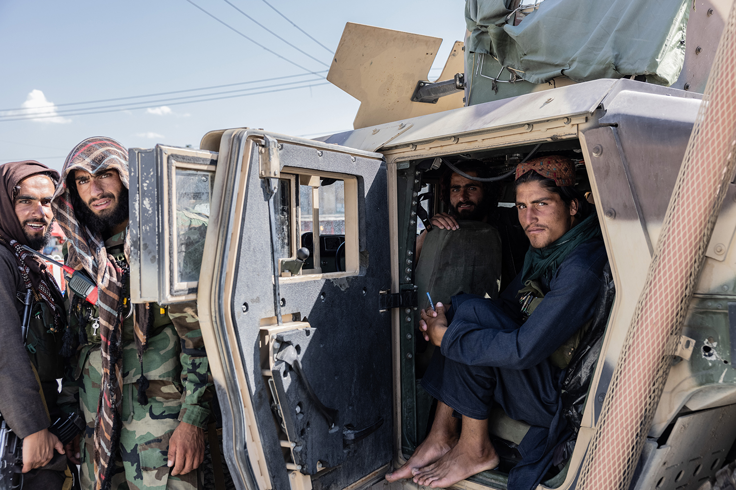 Members of the Taliban in a U.S.-Humvee in Kabul on Sept. 1.