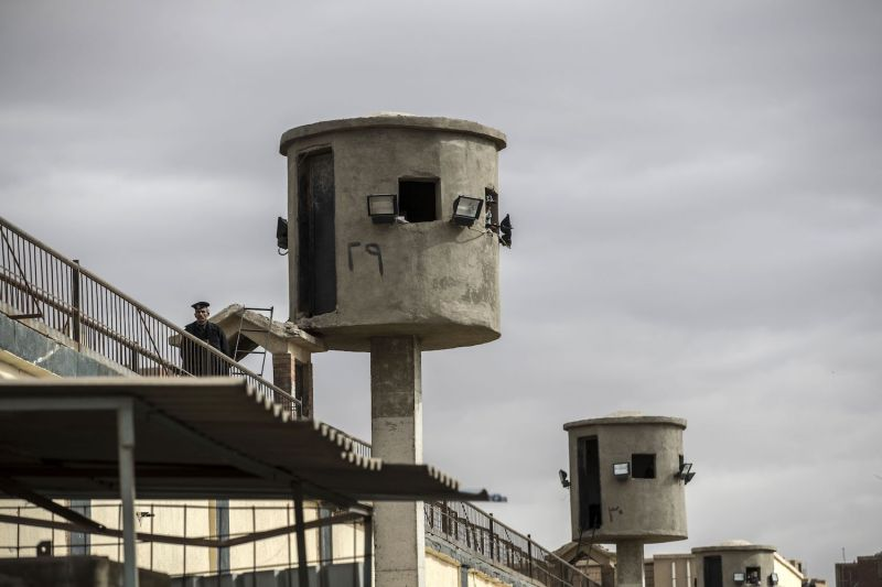 An Egyptian policeman patrols watch towers at Tora Prison on the southern outskirts of Cairo on Feb. 11, 2020.