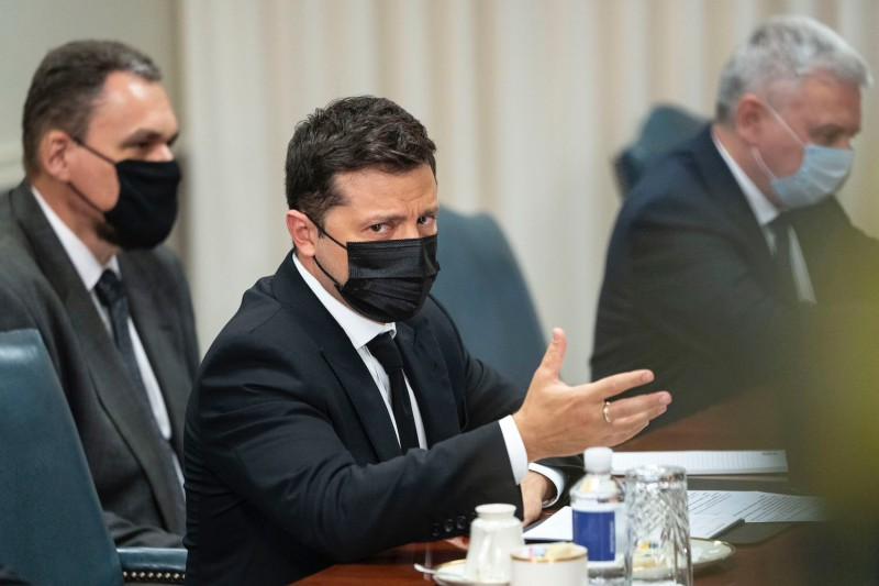 Ukrainian President Volodymyr Zelensky speaks with Lloyd Austin.
