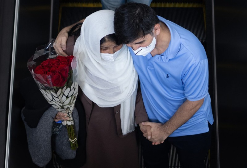 Afghan refugees arrive at Dulles International Airport