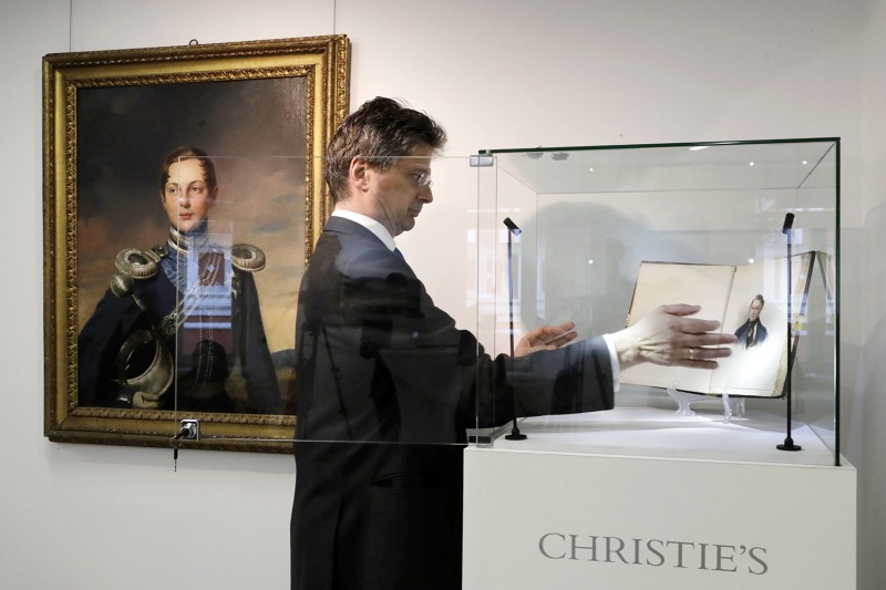 The head of the Russian Art Department at Christie's readies a pre-auction exhibition in Moscow.
