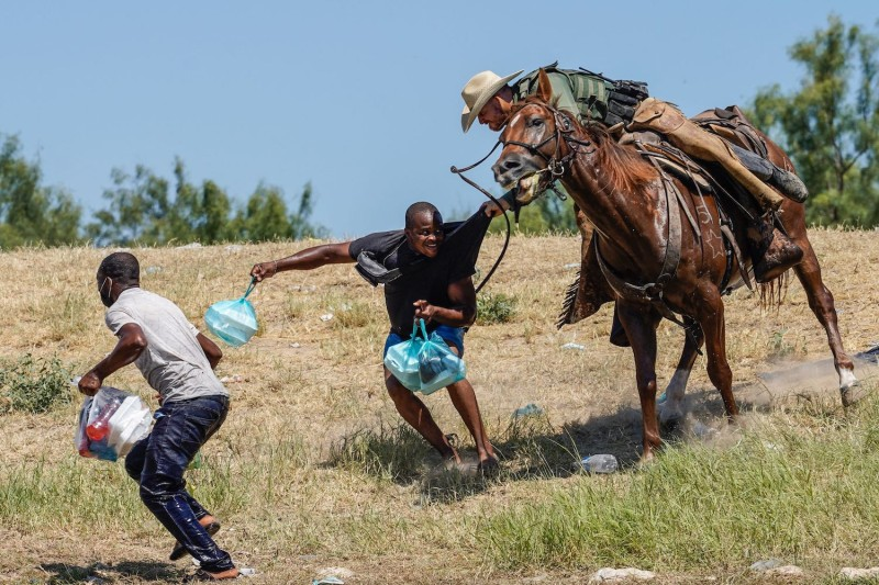 A U.S. Border Patrol agent on horseback tries to stop a Haitian migrant from entering an encampment on the banks of the Rio Grande near the Acuña-Del Rio International Bridge in Del Rio, Texas, on Sept. 19.