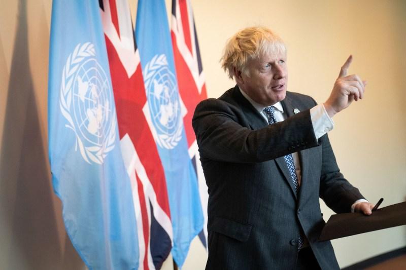 British Prime Minister Boris Johnson addresses the media.