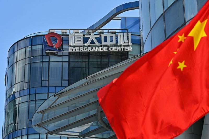 A Chinese flag waves in front of the Evergrande Center building in Shanghai, China, on Sept. 22.