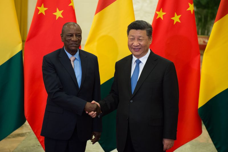 Guinean President Alpha Condé shakes hands with Chinese President Xi Jinping before their bilateral meeting in Beijing on Sept. 1, 2018.