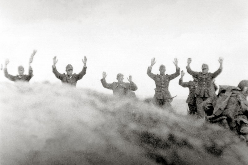 Soldiers of theGerman Wehrmacht stand with their hands up
