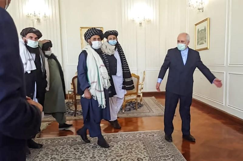 Iranian Minister of Foreign Affairs Javad Zarif meets with Mullah Abdul Ghani Baradar of the Taliban