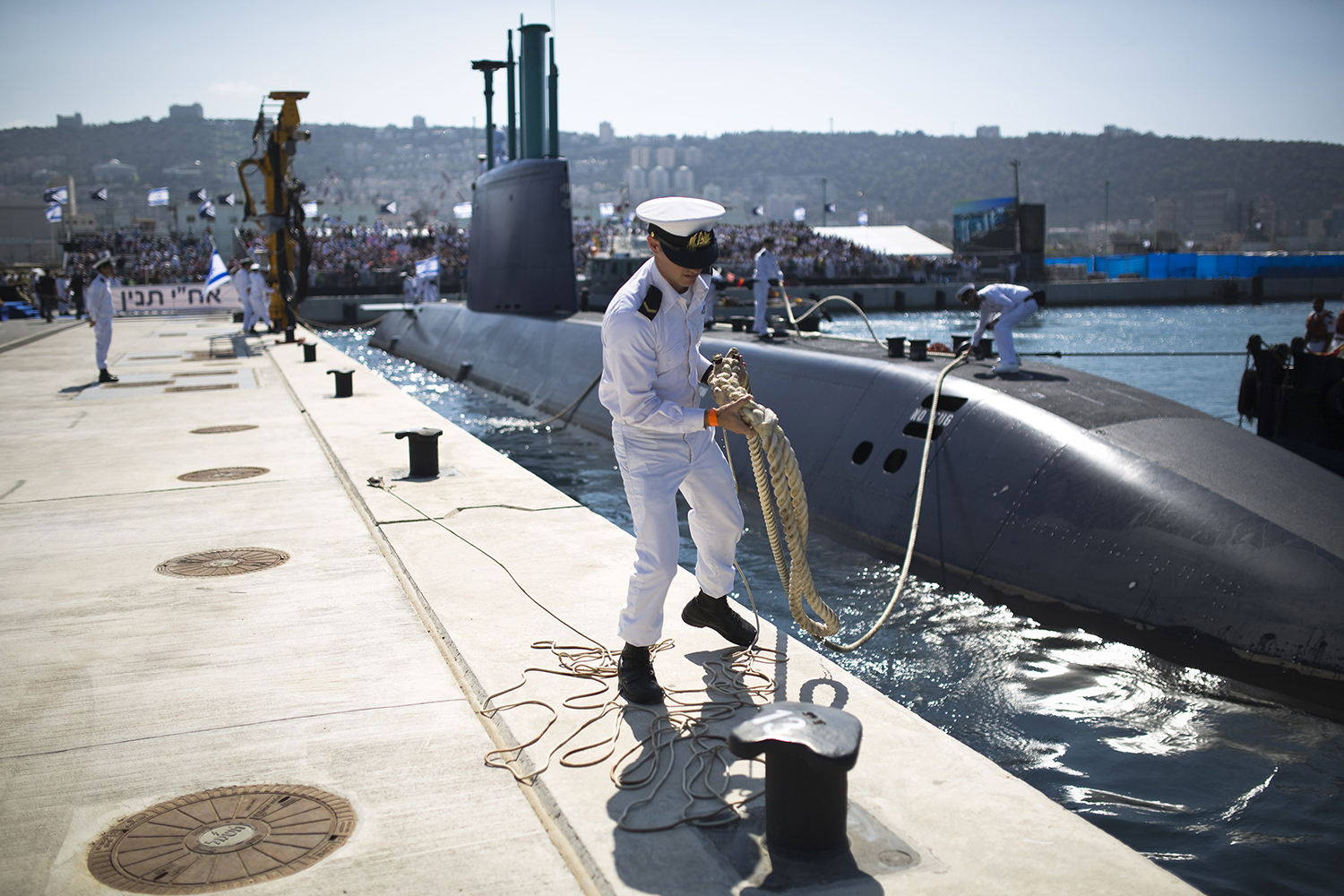An Israeli naval officer holds the mooring rope of an INS Tanin, a Dolphin AIP class submarine, during a ceremony upon its arrival at a naval base in the northern Israeli city of Haifa, on Sept. 23, 2014. Tanin is the first German-built Dolphin AIP class vessel ordered by Israel.