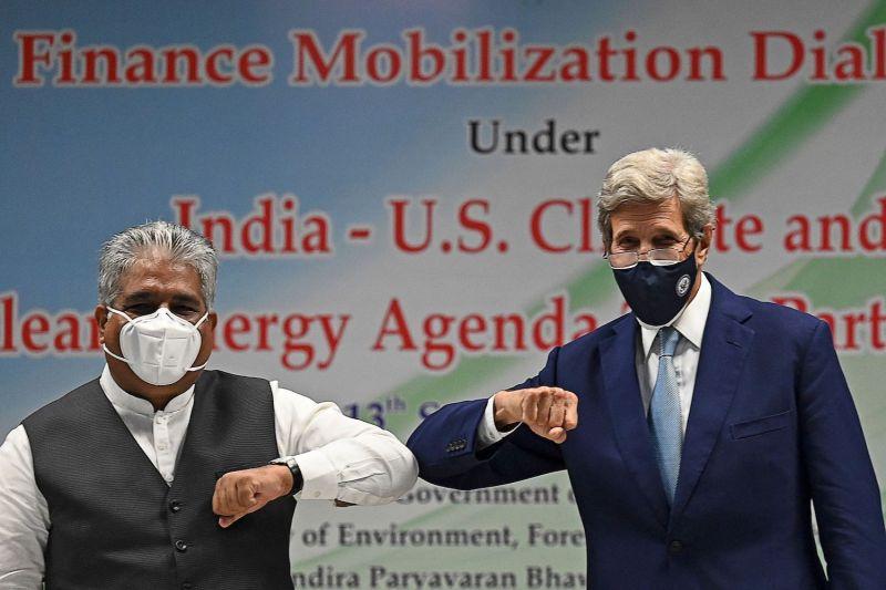 John Kerry and Bhupender Yadav meet.
