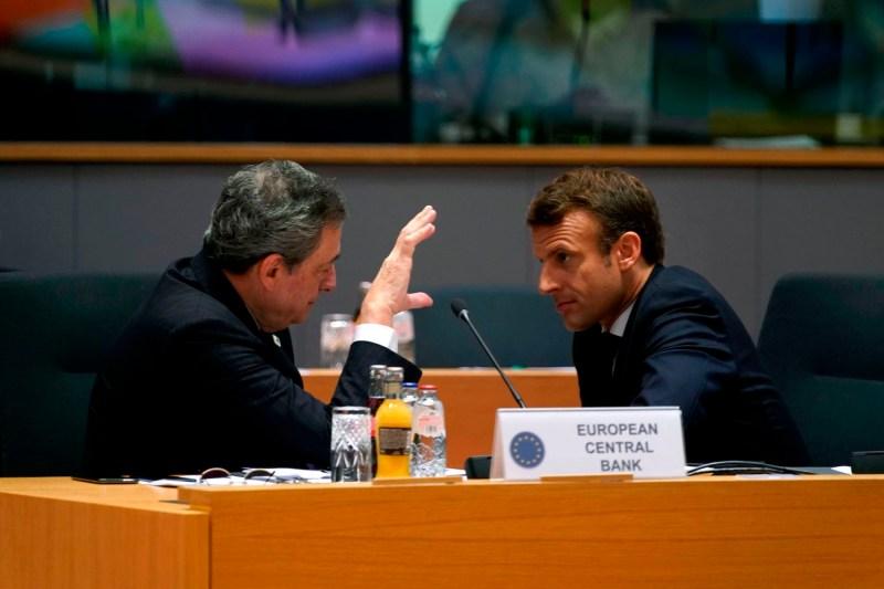 Mario Draghi and Emmanuel Macron speak during an EU summit.