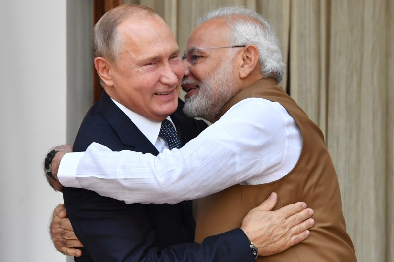 Indian Prime Minister Narendra Modi welcomes Russian President Vladimir Putin before their meeting at Hyderabad House in New Delhi on Oct. 5, 2018.