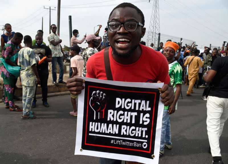 """A man carries a banner that reads """"Digital right is human right"""" during a demonstration in Lagos, Nigeria, on June 12, 2021."""