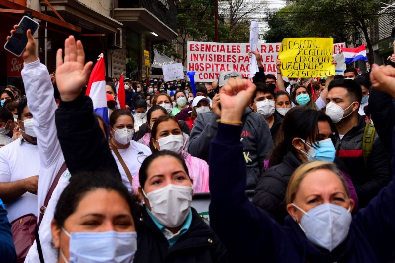 Public hospital nurses demonstrate to demand better salaries and the renewal of their contracts amid the COVID-19 pandemic in Asunción, Paraguay, on Aug. 25.