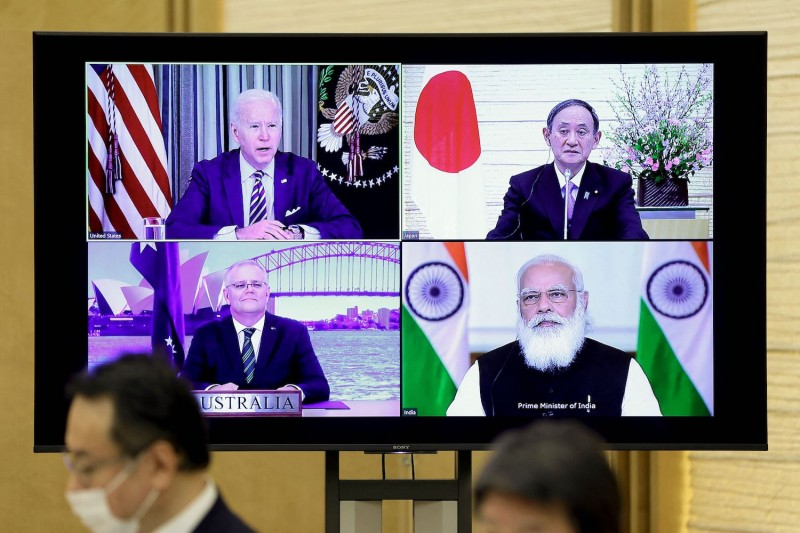A monitor displaying a virtual meeting of the Quadrilateral Security Dialogue with U.S. President Joe Biden (clockwise from top left), Japanese Prime Minister Yoshihide Suga, Indian Prime Minister Narendra Modi, and Australian Prime Minister Scott Morrison is seen from Suga's official residence in Tokyo on March 12.