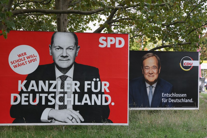 Election campaign billboards show Olaf Scholz, chancellor candidate of the German Social Democratic Party, and Armin Laschet, chancellor candidate of the Christian Democratic Union, in Berlin on Sept. 21.