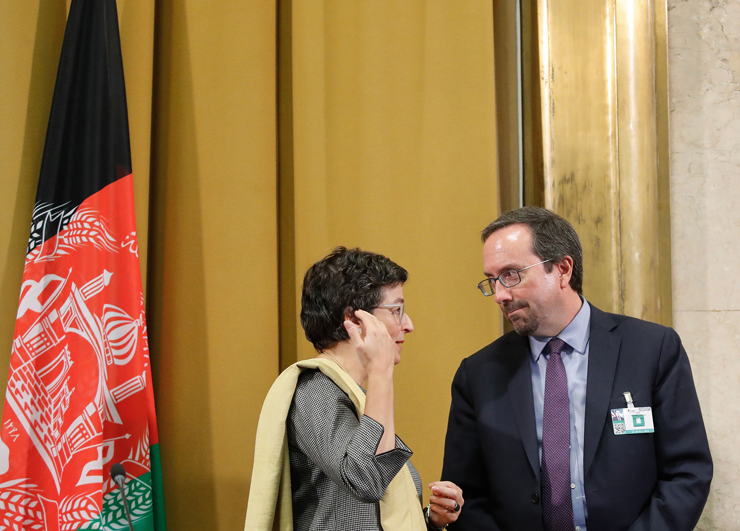 Executive director of the International Trade Centre Arancha Gonzalez talks with John Bass, then U.S. ambassador to Afghanistan, during a U.N. debate on performance of his country's private sector at the Geneva Conference on Afghanistan on Nov. 27, 2018.