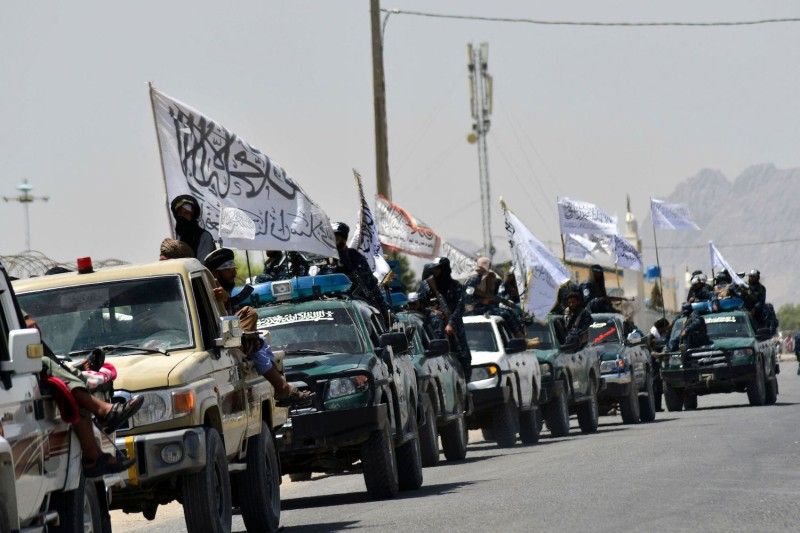 Taliban fighters parade along a road to celebrate after the U.S. withdrawal form Afghanistan in Kandahar, Afghanistan, on Sept. 1.