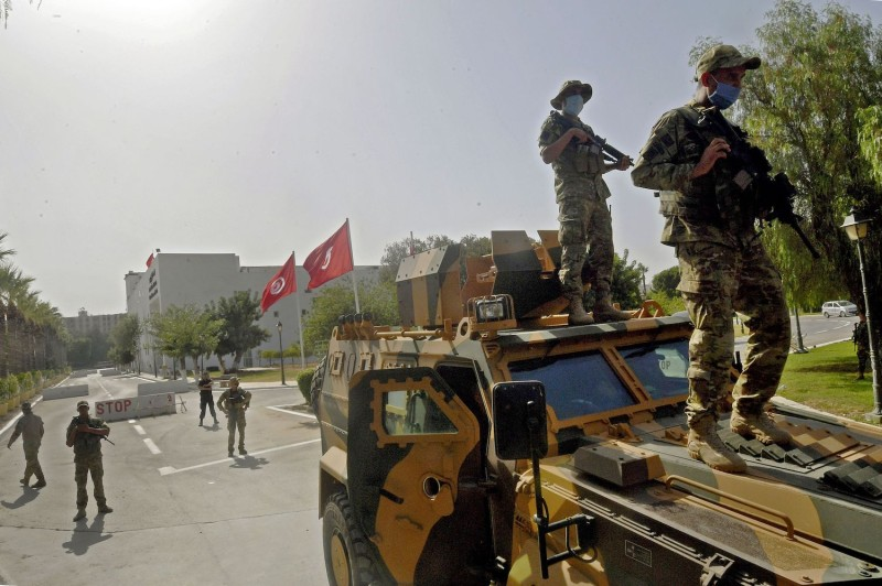 Tunisian military forces guard the area around the parliament building in Tunis, Tunisia, on July 26.