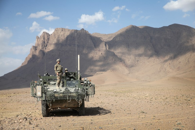 Pfc. William Berczik stands on top of a Stryker vehicle in the desert near Kandahar, Afghanistan, on March 6, 2014.