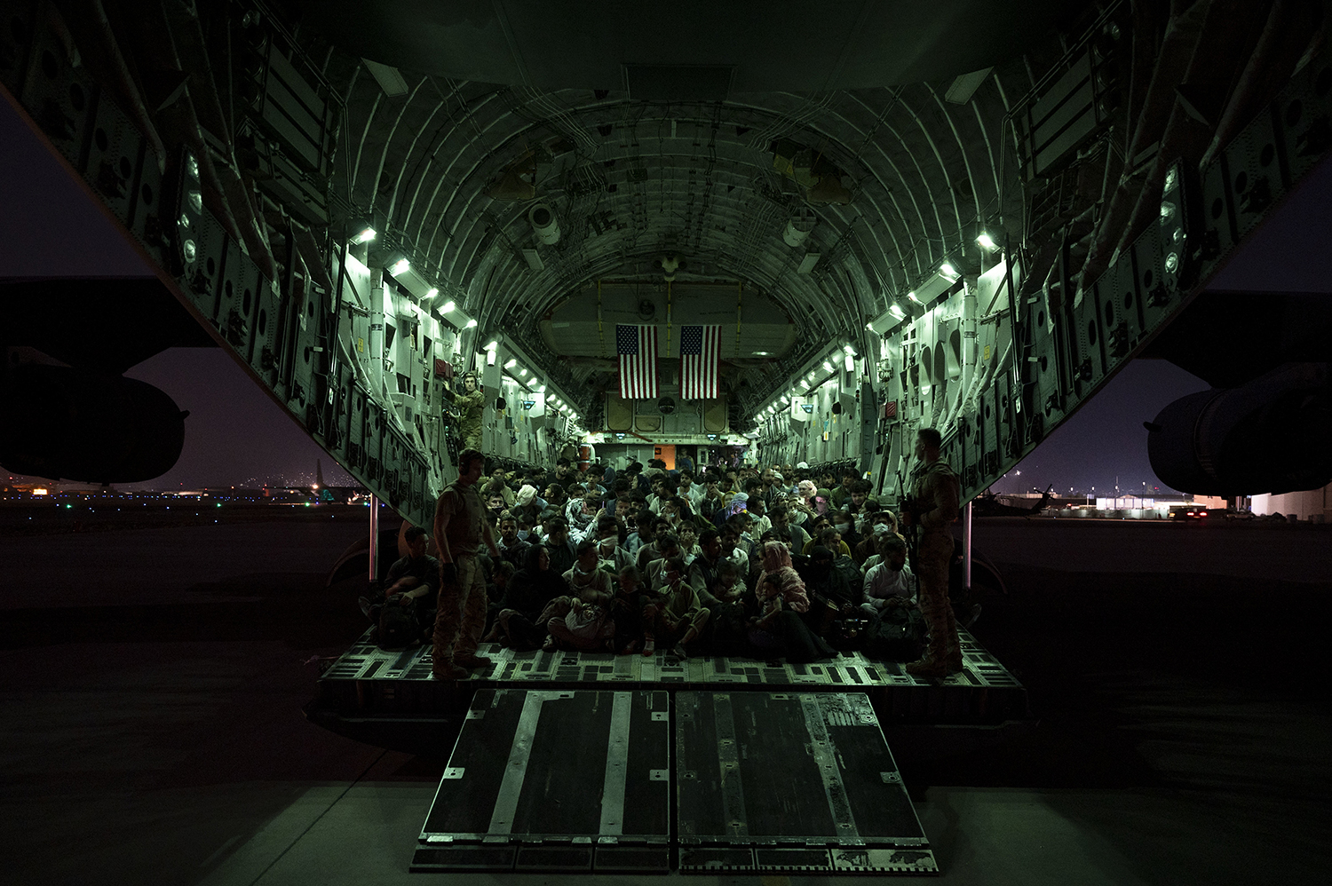 An air crew assigned to the assists evacuees aboard a C-17 Globemaster III aircraft in support of the Afghanistan evacuation at the Kabul airport on Aug. 21 in a U.S. Air Force handout photo.