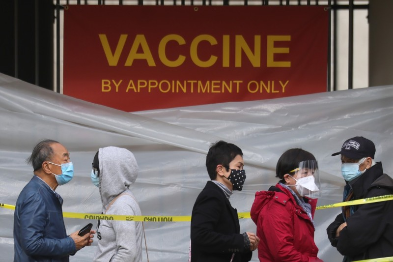 People stand in line to receive the COVID-19 vaccine at a vaccination site in Los Angeles, California, on Jan. 28.