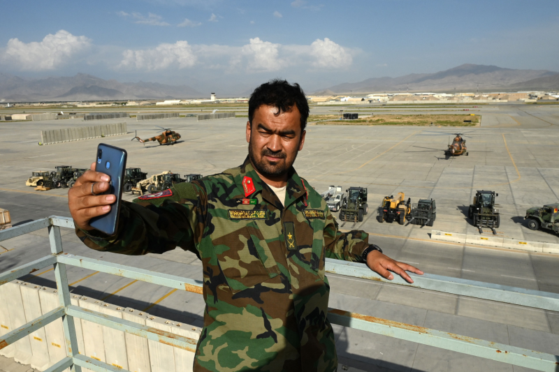 An Afghan National Army soldier takes a selfie