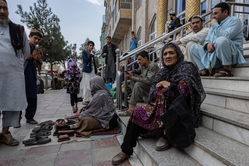 A woman begs on the streets of Kabul.