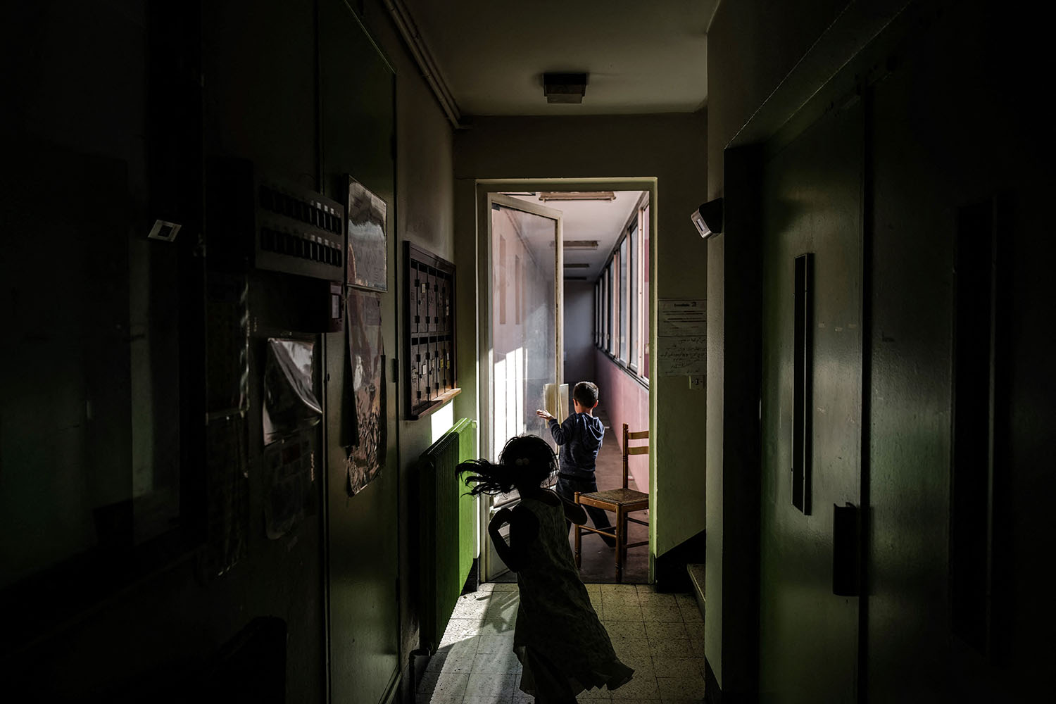 Children play in a corridor of a building just as Afghan refugee families arrive after their evacuation from Kabul in Villeurbanne, France, on Aug. 31. Olivier Chassignole/AFP via Getty Images