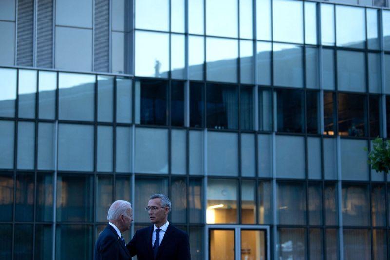 Biden and Stoltenberg talk after a summit at NATO headquarters.