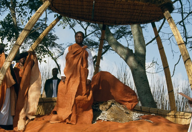 Ronald Muwenda Mutebi II of Buganda stands under a shelter during his enthronement ceremony in 1993.
