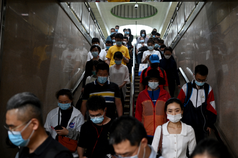 Commuters head to the subway in Beijing