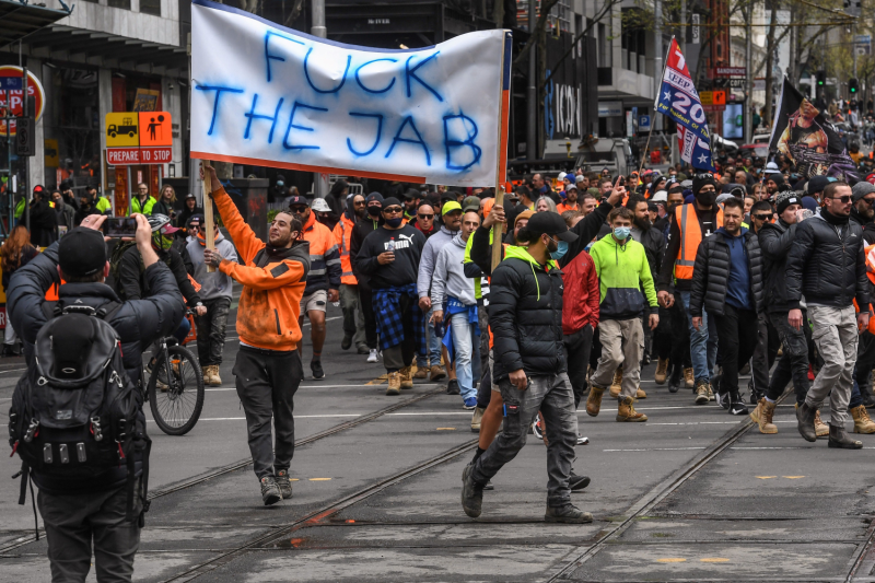 Construction workers and demonstrators attend a protest against COVID-19 regulations in Melbourne, Australia, on Sept. 21.