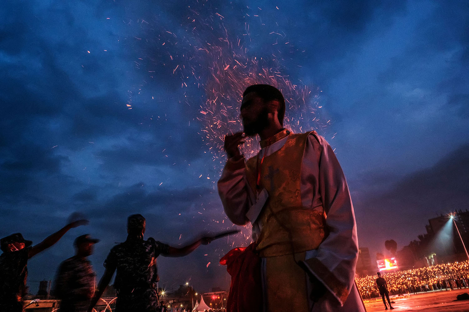 An Ethiopian Orthodox devotee stands in front of a bonfire during celebrations of the eve of the Ethiopian Orthodox holiday of Meskel in Addis Ababa, Ethiopia, on Sept. 26. Eduardo Soteras/AFP via Getty Images