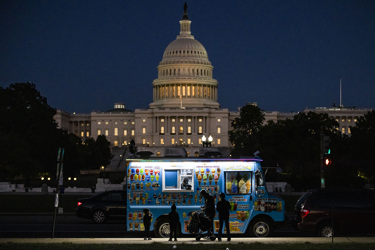 An ice cream truck is parked a short distance from the U.S. Capitol as Congress heads into session to meet the deadline for debt ceiling negotiations and discuss an infrastructure bill in Washington on Sept. 26. Samuel Corum/Getty Images