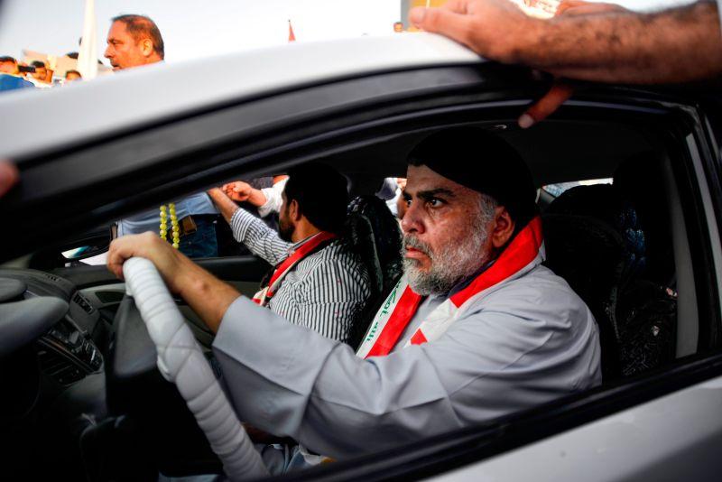 Muqtada al-Sadr drives a car.