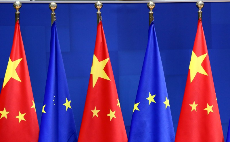 Flags of the EU and China are seen as European Commission President Ursula von der Leyen, European Council President Charles Michel, German Chancellor Angela Merkel, French President Emmanuel Macron and Chinese President Xi Jinping attend a video conference to approve an investment pact between China and the European Union on December 30, 2020 in Brussels, Belgium.