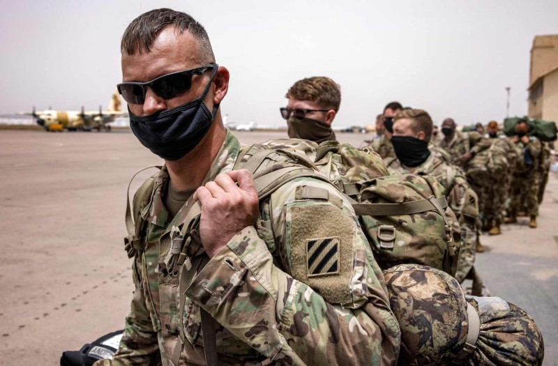 """US army soldiers arrive at Morocco's Agadir military airport on June 9, 2021 to take part in the """"African Lion"""" military exercise."""