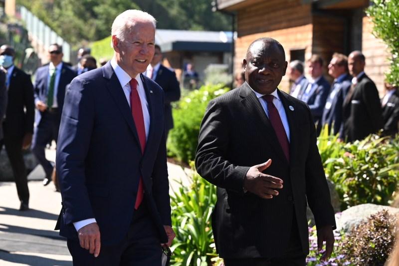 U.S. President Joe Biden talks with South African President Cyril Ramaphosa.