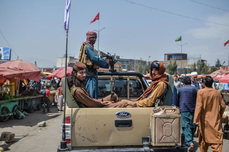 Taliban fighters on a pickup truck in Kabul.