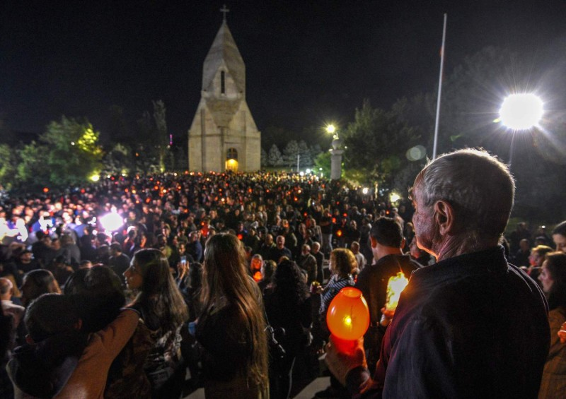 People hold candles during a rally in Yerevan, Armenia, on September 26, 2021. Around 3,000 Armenians marched in capital Yerevan on September 26, 2021, to commemorate the victims of the war with arch-foe Azerbaijan over the disputed Nagorno-Karabakh region the year before.